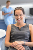 Businesswoman patient at dental surgery checkup — Stock Photo
