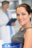 Elegant woman patient at dentist surgery smiling — Stock Photo