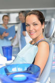 Patient on chair dental surgery dentist assistant — Stock Photo