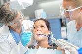 Woman patient dental check dentist team — Stock Photo