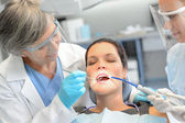 Dental check woman patient dentist team — Stock Photo