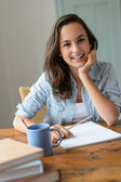 Student girl studying at home — Stockfoto