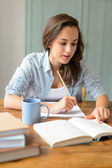Student girl studying at home — Stock Photo