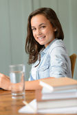 Teenage girl student at home — Stock Photo