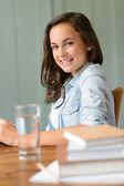 Teenage girl student at home — Stock Photo