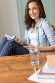 Girl reading magazine at home — Stock Photo