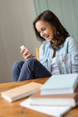 Girl looking at mobile phone — Stock Photo