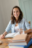 Teenage girl studying at home — Stock Photo