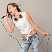 Singing teenage girl with microphone — Stock Photo