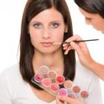Make-up artist woman fashion model apply lipstick — Stock Photo #6441644