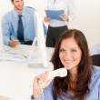 Business team pretty businesswoman holding phone — Stock Photo #6935464