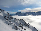 Clouds in a valley in Alps — Foto de Stock