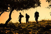 Three soldiers patrolling during sunset — Stock Photo