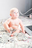 Business baby boy with money — Stock Photo