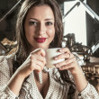 Portrait of a beautiful woman with a cup of tea — Stock Photo