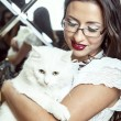 Beautiful brunette with cat — Stock Photo #17857083