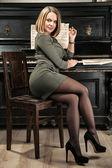 Sexy girl near the vintage piano — Stock Photo