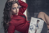 Attractive girl reading a fashion magazine — Stock Photo