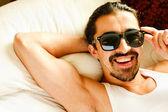 Sexy man in sunglasses — Stock Photo