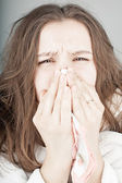 Sneezing young attractive woman — Foto Stock