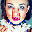 Beautiful brunette bleeding woman — Stock Photo
