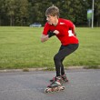 Stock Photo: Sportsmon roller skates achive great speed