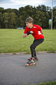 Sportsman on roller skates achive great speed — Stock Photo