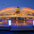 Stock Photo: Revolving carousel enlarge ride speed by twice