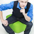 Student sit on green ball and thinking - Stock Photo