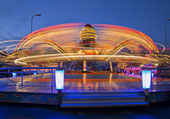 Revolving carousel enlarge ride speed by twice — Stock Photo