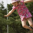 Stock Photo: Girl is captured on camerwhile jumping