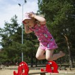 Stock Photo: Girl captured on camerwhile jumping