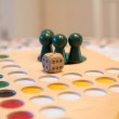 Buttons on table game field with die — Stock Photo #18899585