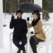 Man and woman waiting rain at winter — Stock Photo