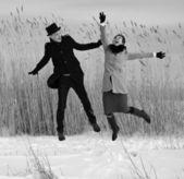 Shaded man and woman jump on lake — Stock Photo