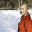 Постер, плакат: Woman in red coat with firmly look