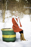 Young woman sitting on empty big flowerpot — Stock Photo