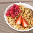Zoomed view on berrie halfs on cereals — Stock Photo #25033141
