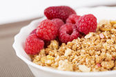 Zoomed berries on golden cereals in bowl — Stock Photo