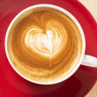 Zoomed cup of coffee with foam heart — Stock Photo #25333787