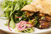 Pitta bread with onion, meat and accessories — Stock Photo