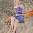 Stock Photo: Womin dress take sunbath on beach