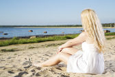 Woman in white dress relax on beach — Stock Photo