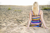 Woman in dress take sunbath at day — Stock Photo