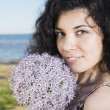 Young woman with dark hairs with flower — Stock Photo #28998293