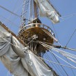 Mast with collected sails at windy day — Stock Photo