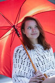 Young woman with open umbrella at hand — Stock Photo