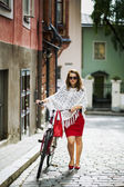 Woman in red walking on street — Stock Photo