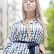 Foto Stock: Womin checkered dress at bright daylight