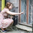 Stock Photo: Womin dress drawing on window glass